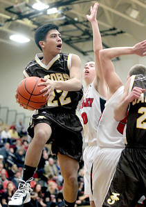 Sarah Nader - snader@shawmedia.com Jacobs' Patrick Nerja passes to a teammate during the second quarter of Tuesday's game at Huntley High School on February 12, 2013. Huntley won, 54-26.