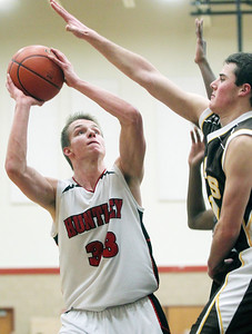 Sarah Nader - snader@shawmedia.com Huntley's Zach Gorney shoots over a Jacobs' player during the fourth quarter of Tuesday's game at Huntley High School on February 12, 2013. Huntley won, 54-26.