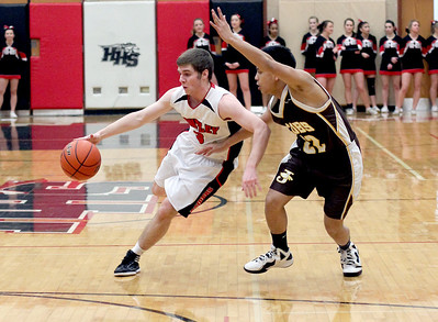 Sarah Nader - snader@shawmedia.com Huntley's Tommy Regan (left) is guarded by Jacobs' Patrick Nerja during the third quarter of Tuesday's game at Huntley High School on February 12, 2013. Huntley won, 54-26.