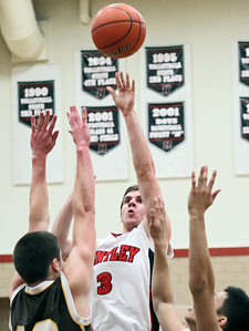 Sarah Nader - snader@shawmedia.com Huntley's Tommy Regan (center) shoots over Jacobs' Ryan Billings (left) and Patrick Nerja during the second quarter of Tuesday's game at Huntley High School on February 12, 2013. Huntley won, 54-26.