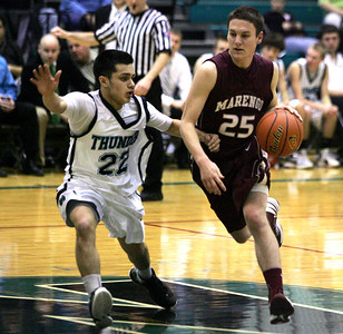 Monica Maschak - mmaschak@shawmedia.com Marengo's Jesse Darlington moves down court in the IHSA 3A Boys Regional game at Woodstock North on Wednesday, February 27, 2013. Woodstock North beat Marengo 67-54.