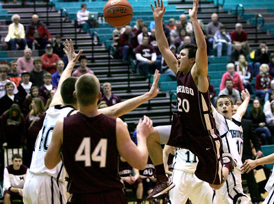 Monica Maschak - mmaschak@shawmedia.com Marengo's Justin Velasquez has the ball knocked out of his hands in the process of aiming for the net in the IHSA 3A Boys Regional game at Woodstock North on Wednesday, February 27, 2013. Woodstock North beat Marengo 67-54.