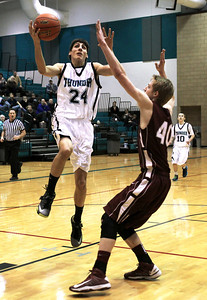 Monica Maschak - mmaschak@shawmedia.com Woodstock North's Nick Herscha attempts a layup in the final quarter od the IHSA 3A Boys Regional game at Woodstock North on Wednesday, February 27, 2013. Woodstock North beat Marengo 67-54.