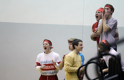 Sarah Nader - snader@shawmedia.com Marian Central fans cheer on the boys basketball team during Monday's IHSA 3A Boys Basketball Regional against Harvard in Woodstock on February 25, 2013. Marian Central won, 55-41.