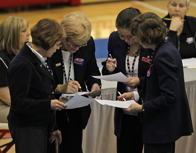H. Rick Bamman - hbamman@shawmedia.com IHSA judges confer on a score at the Illinois Gymnastics State Finals held at Palatine High School.