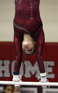 H. Rick Bamman - hbamman@shawmedia.com Prairie Ridge's Rachael Underwood performs a routine on the uneven bars Friday, Feb. 15, 2013 at the IHSA State Gymnastics preliminaires at Palatine High School.