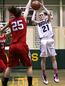 Monica Maschak - mmaschak@shawmedia.com Prairie Ridge's Kelly Klendworth attempts three points in the first half of the first round of the single elimination IHSA Regional Playoffs held at Crystal Lake South on Monday, February 11, 2013. Prairie Ridge beat Grant 58-37 and will advance to the next round.