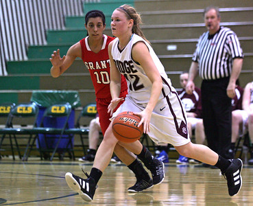 Monica Maschak - mmaschak@shawmedia.com Amanda Hoyland, for Prairie Ridge, looks to pass the ball in the first round of the single elimination IHSA Regional Playoffs held at Crystal Lake South on Monday, February 11, 2013. Prairie Ridge beat Grant 58-37 and will advance to the next round.