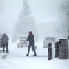 Aldi shoppers make their way to their cars during Tuesday afternoon's snow storm in Geneva.(Sandy Bressner photo)