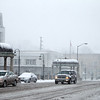 Cars travel on Route 64 in downtown St. Charles during Tuesday afternoon's snow storm.(Sandy Bressner photo)
