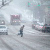 A man crosses Route 64 in downtown St. Charles during Tuesday afternoon's snow storm.(Sandy Bressner photo)