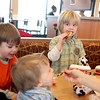 Clark Egly, 3, (far right) of North Aurora eats a chicken sandwich with his brothers, George, 5, and Paul, 1, and his mom, Kathryn, on the opening morning of Chick-fil-A in Batavia Thursday.(Sandy Bressner photo)