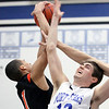 St. Charles North's Quinten Payne and St. Charles East's AJ Washington battle for a rebound during Saturday's game at St. Charles North High School. (Jeff Krage photo for the Kane County Chronicle)