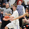St. Charles North's Jake Ludwig takes the basketball up the court while being guarded by St. Charles East's AJ Washington during Saturday's game at St. Charles North High School. (Jeff Krage photo for the Kane County Chronicle)