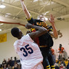 Batavia's Jake Pollack (3) shoots over De La Salles' Brandon Hutton (35) at Batavia High School in Batavia, IL on Saturday, February 02, 2013 (Sean King for The Kane County Chronicle)