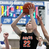 St. Charles East's James McQuillain takes a shot during Saturday's game at St. Charles North High School. (Jeff Krage photo for the Kane County Chronicle)
