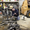 Ron Bychowski, maintenance supervisor for Gould Farms in Maple Park, takes apart part of a planter to be cleaned and repainted in preparation for the spring season.(Sandy Bressner photo)