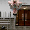 St. Charles East diver practices at the school Tuesday. Schmitt will be competing in the state meet at New Trier High School this weekend.(Sandy Bressner photo)