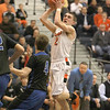 St. Charles East's Dom Adduci goes up for a shot during their South Elgin Regional game against St. Charles North Wednesday.(Sandy Bressner photo)