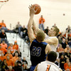 St. Charles East's Ben Skoog goes up for a shot during their South Elgin Regional game against St. Charles North Wednesday.(Sandy Bressner photo)