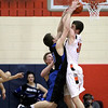 St. Charles East's David Mason (right) battles Ryan Thomas of St. Charles North for a rebound during their South Elgin Regional game Wednesday.(Sandy Bressner photo)