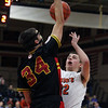 St. Charles East's James McQuillain has his shot blocked by Batavia's Zach Strittmatter during Saturday's game in St. Charles.<br /> (Jeff Krage photo for the Kane County Chronicle)