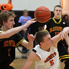 St. Charles East's Ethan Griffiths and Batavia's Luke Horton battle for a loose ball during Saturday's game in St. Charles.<br /> (Jeff Krage photo for the Kane County Chronicle)