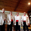 (Left to right) Members of the Chordaholics Ralph Price, Ron Schulz, Bob Potthast and Jim Pedersen sing to Olie Gilmore (not pictured) in her St. Charles area home Thursday. The singing telegram was a gift to Olie from her daughter for Valentine's Day.(Sandy Bressner photo)