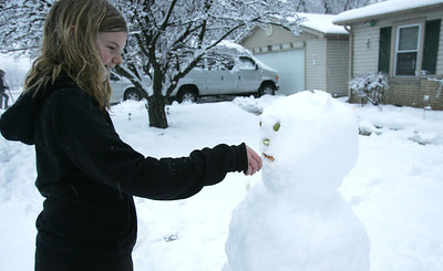 H. Rick Bamman - hbamman@shawmedia.com Melissa Urukalo finishes her snowman in the front yard of her Lake in the Hills home.