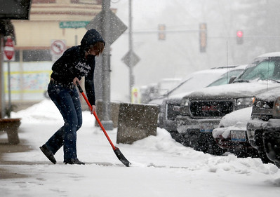 Sarah Nader - snader@shawmedia.com Kasey Arney, 20 of Belvidere shovels while working at The Blingy Gal Boutique in Marengo on Thursday, February 7, 2013. Moderate to heavy snowfall is expected throughout the early evening, according to the weather service.