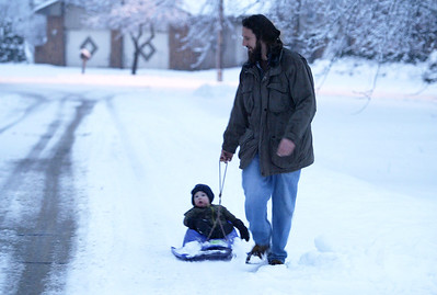 H. Rick Bamman - hbamman@shawmedia.com Jeff Kakubik pulls his son Johnny along Seminole Tr. in Lake in the Hills. A winter weather warning remained in effect through midnight Thursday as motorists have been reporting driving conditions as treacherous.