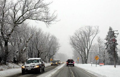 Sarah Nader - snader@shawmedia.com Traffic was backed on Route 14 in Crystal Lake as snow hit McHenry County on Thursday, February 7, 2013. Moderate to heavy snowfall is expected through the early evening, according to the weather service.