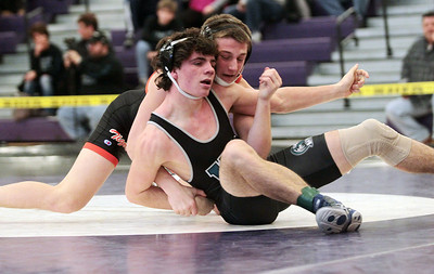 Sarah Nader - snader@shawmedia.com Crystal Lake Central's Kyle Fugiel (back) wrestles Woodstock North's Cody Kupsik during the 145-pound weight class match at Saturday's IHSA Regional in Hampshire on February 2, 2013. Fugiel won the match.