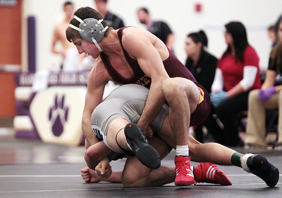 Sarah Nader - snader@shawmedia.com Richmond-Burton's Garrett Sutton (right) wrestles Hampshire's Joe McAlpin during the 152-pound weight class match at Saturday's IHSA Regional in Hampshire on February 2, 2013. Sutton won the match.