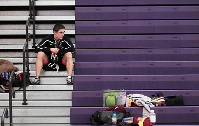 Sarah Nader - snader@shawmedia.com Crystal Lake Central's Brent Pfaff waits for his match during Saturday's IHSA Regional in Hampshire on February 2, 2013.