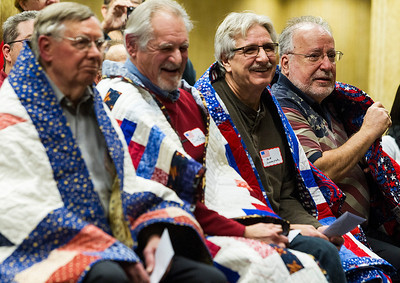 Kyle Grillot - kgrillot@shawmedia.com   Veterans Donald McLeod, (from left) Jim Czysz, Bob Lobewyck, and Ron McLaughlin watch as other veterans are presented with their quilts during the Quilts of Valor presentation Tuesday at American Community Bank in Huntley. The national organization has awarded over 96,000 quilts since 2003. The bank has donated their basement for the group to use on the first Tuesday of every month. Local veterans from many wars were awarded the hand-made quilts Tuesday in Huntley, and there is an application process for other local veterans to receive the award.