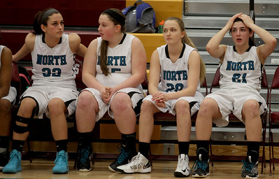 Sarah Nader - snader@shawmedia.com Woodstock North players react during the last seconds of  Tuesday's IHSA Class 3A Regionals against Woodstock  in Richmond February 18, 2014. Woodstock defeated Woodstock North, 54-50.