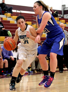 Sarah Nader - snader@shawmedia.com Woodstock North's Samantha Abbate (left) is guarded by Woodstock's Gabby Scolio while she brings the ball towards the basket during the second quarter of Tuesday's IHSA Class 3A Regionals in Richmond February 18, 2014. Woodstock defeated Woodstock North in double overtime, 54-50.