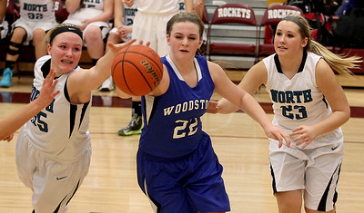 Sarah Nader - snader@shawmedia.com Woodstock North's Haley Ahr (left), Woodstock's Brecken Overly and Woodstock North's Ashley Jones go after a lose ball during double overtime at Tuesday's IHSA Class 3A Regionals in Richmond February 18, 2014. Woodstock defeated Woodstock North in double overtime, 54-50.