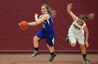 Sarah Nader - snader@shawmedia.com Woodstock's Brecken Overly (left) runs past Woodstock North's Ashley Jones during the second quarter of Tuesday's IHSA Class 3A Regionals  in Richmond February 18, 2014. Woodstock defeated Woodstock North in double overtime, 54-50.