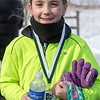 Audrey O'Conner 9, from Batavia smiles after completing her first 5K race at The Super Shuffle 5K at Geneva Middle School South in Geneva, IL on Sunday, February 02, 2014 (Sean King for Shaw Media)