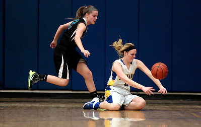 Kyle Grillot - kgrillot@shawmedia.com  Woodstock North junior Ashley Jones and Jaohnsburg junior Madie Rowe rush for a loose ball during the first quarter of the girls basketball game Monday in Johnsburg. Johnsburg beat Woodstock North, 51-33.