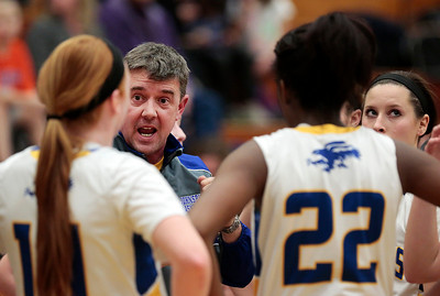 Kyle Grillot - kgrillot@shawmedia.com  Johnsburg head coach Brad Frey talks with his players during a time out in the fourth quarter of the girls basketball game Monday in Johnsburg. Johnsburg beat Woodstock North, 51-33.