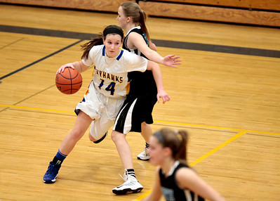 Kyle Grillot - kgrillot@shawmedia.com  Johnsburg senior Kayla Toussaint (14) dribbles around Wodstock North sophomore Martha Everly during the fourth quarter of the girls basketball game Monday in Johnsburg. Johnsburg beat Woodstock North, 51-33.