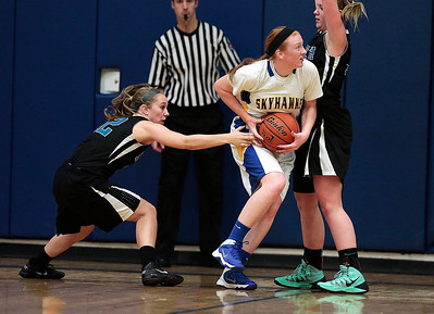 Kyle Grillot - kgrillot@shawmedia.com  Johnsburg junior Carly Wilson (center) goes to put up a shot under pressure from Woodstock North sophomore Jennifer Crain (left) and sophomore Haley Ahr during the first quarter of the girls basketball game Monday in Johnsburg. Johnsburg beat Woodstock North, 51-33.