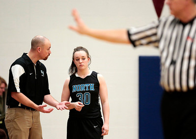 Kyle Grillot - kgrillot@shawmedia.com  Woodstock North had coach Mike Lewis talks with sophomore Martha Everly during the fourth quarter of the girls basketball game Monday in Johnsburg. Johnsburg beat Woodstock North, 51-33.