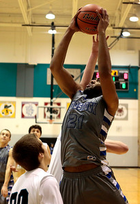 Kyle Grillot - kgrillot@shawmedia.com  Woodstock senior Damian Stoneking puts up a shot during the first quarter of the boys basketball game Tuesday in Woodstock. Woodstock beat Woodstock North, 54-27.