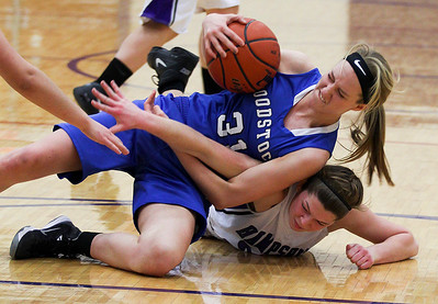 Sarah Nader- snader@shawmedia.com Woodstock's Dakota Brand (left) and Hampshire's Tricia Dumoulin battle over a loose ball during the first quarter of Wednesday's game in Hampshire February 5, 2014. Hampshire defeated Woodstock, 58-36.