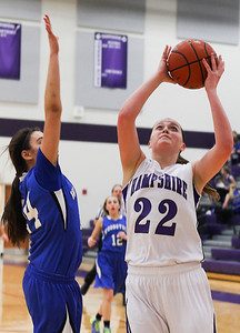Sarah Nader- snader@shawmedia.com Hampshire's Emma Benoit shoots during the third quarter of Wednesday's game against Woodstock February 5, 2014. Hampshire defeated Woodstock, 58-36.