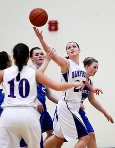 Sarah Nader- snader@shawmedia.com Hampshire's Emma Benoit grabs the rebound during the second quarter of Wednesday's game against Woodstock in Hampshire February 5, 2014. Hampshire defeated Woodstock, 58-36.